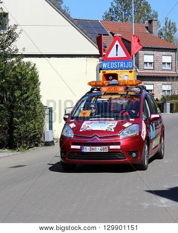 AALST, BELGIUM MAY 5 2016: The leading safety car during an amateur bike race through the streets of Aalst, in East Flanders Belgium. Safety cars are required by law.