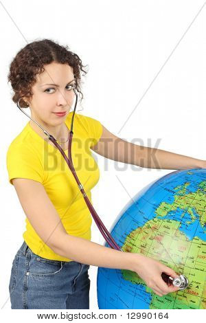 young beauty woman with stethoscope and big inflatable globe, half body, vertical, isolated on white