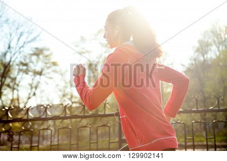 Attractive Happy Woman Jogging In Park