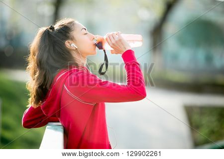 Runner Woman Drinking After Exercises