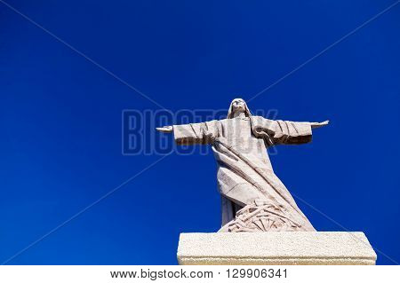 the statue of Jesus Christ with a blue sky background at Garajau in Funchal Madeira