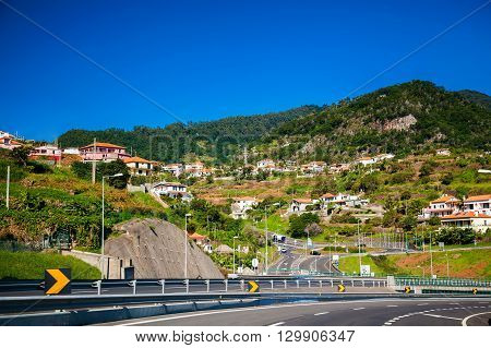 the highway along small village in Madeira island Portugal