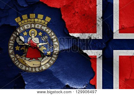 flags of Oslo and Norway painted on cracked wall