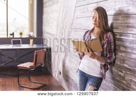Female With Notebook In Hands