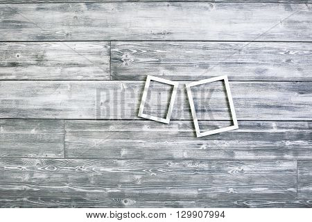 Empty picture frames on antique wooden wall. Mock up
