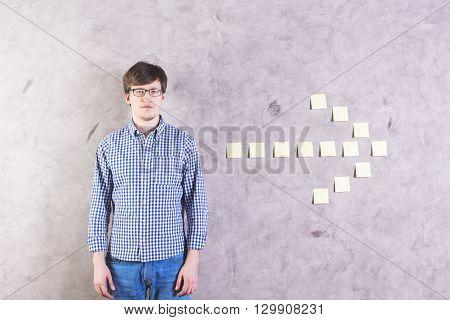 Male Next To Sticker Arrow