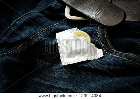 Condom In The Blue Jeans. Focus On The Condom.