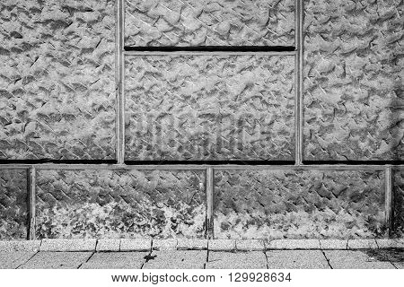 wall of sandstone blocks and pavement for background or texture