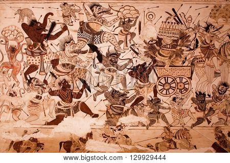ORCHHA, INDIA - DEC 21, 2012: Demons and devils are fighting with the gods on the mural at Lakshmi Narayana Temple on on December 21, 2012 in Orchha, India. The temple was built by King Veer Singh in 1622