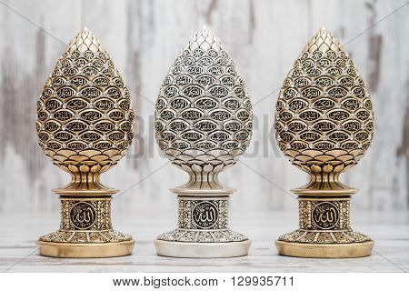 Silver And Golden Religious Statuettes With The Names Of Allah