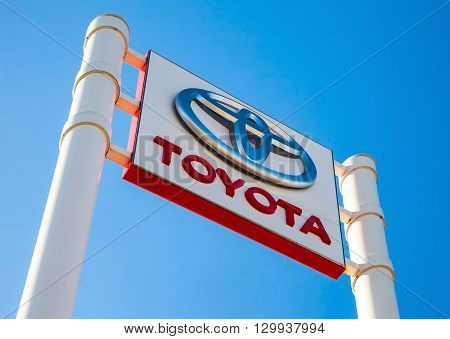 SAMARA RUSSIA - MAY 14 2016: Official dealership sign of Toyota against the blue sky background. Toyota Motor Corporation is a Japanese automotive manufacturer