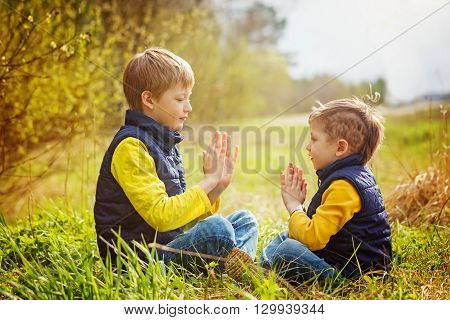 Happy two litte brothers having fun together at the sunny day time. Concept Brothers Friendship