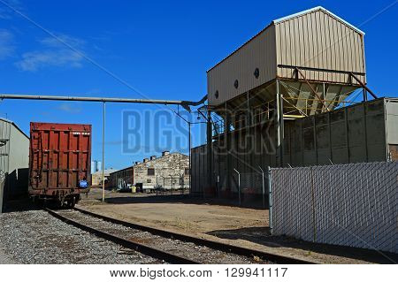 KERN COUNTY, CA -  MAY 15, 2016: Boxcars are lined up on a railroad siding awaiting the loading of fertilizers and agricultural chemicals at a Central California processing plant.