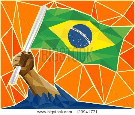 A Strong Hand Raising The Brazilian Flag