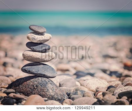 Zen meditation background -  vintage retro effect filtered hipster style image of balanced stones stack close up on sea beach