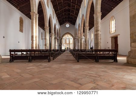Santarem, Portugal. September 11, 2015: The aisle and Naves of the Santa Clara Church. 13th century Mendicant Gothic Architecture. Santarem is called the Capital of Gothic in Portugal.