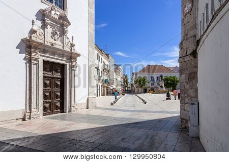 Santarem, Portugal. September 11, 2015: Portal of the Nossa Senhora da Piedade Church, with a view of the Sa da Bandeira Square. 17th century Mannerist church.