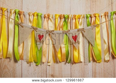 Wedding Flags With Free Space Hanging With Ribbons On Light Wooden Background