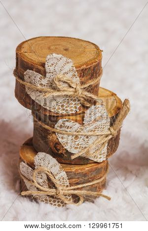 Rustic background with wooden card holders and lace heart