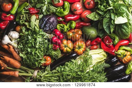 Variety of resh raw vegetable ingredients for healthy cooking or salad making, top view. Diet or vegetarian food concept, horizontal composition