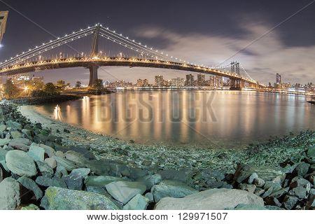New York City Manhattan Bridge Over Hudson River With Skyline After Sunset Night View Illuminated Wi