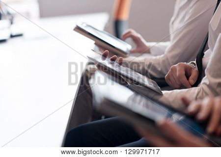 group of business people on meeting  using tablet computer in modern bright startup office interior