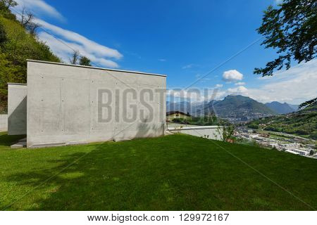 lawn of a modern house in cement, blue sky