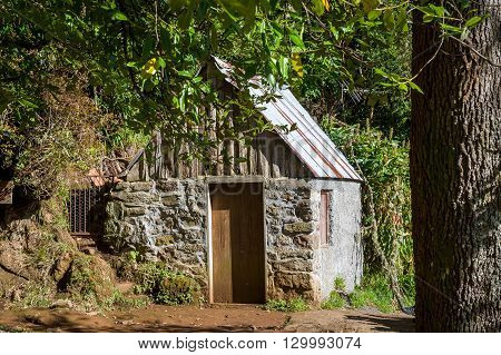 Small stone house in the rain forests of Balcoes levada hiking route. Madeira, Portugal.