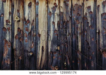 Vintage dark wooden background. Beige and dark blue old board. Wood background. Wood texture.