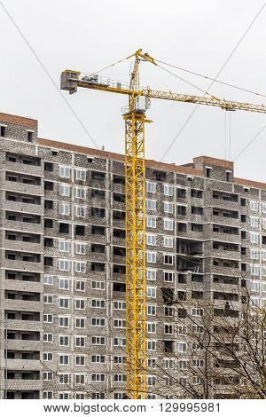 Under construction high-rise apartment building in a residential area of the city