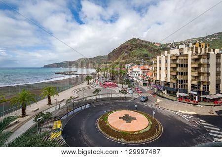Ribeira Brava popular touristic town central square and Atlantic ocean embankment aerial view. Madeira island, Portugal.
