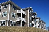 Low angle view of modern apartment building in NH poster