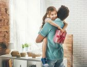 Happy loving family and Father's Day. Father and his daughter. Cute child girl gives a gift to dad. poster