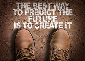 Top View of Boot on the trail with the text: The Best Way to Predict Your Future is to Create It poster
