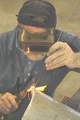 man welding poster
