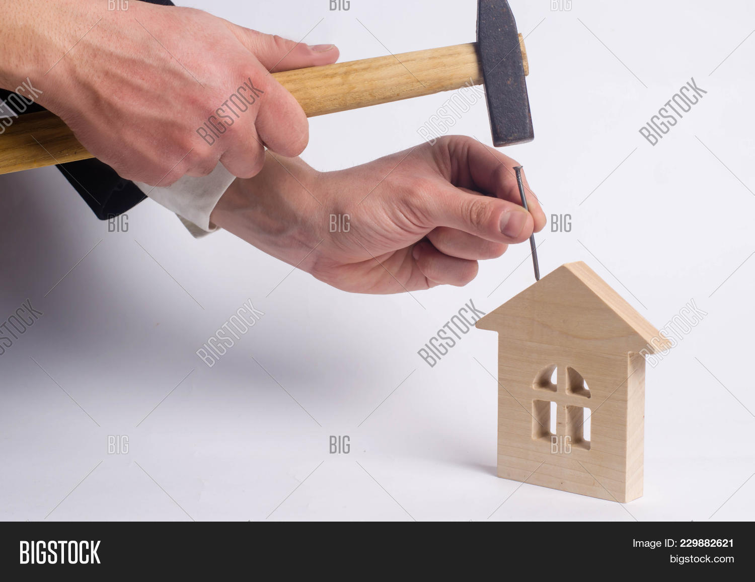 The House Of Hammer man hammers nail image & photo (free trial) | bigstock