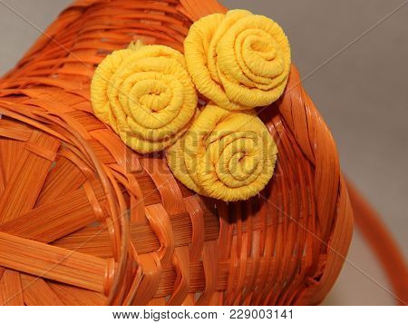 Orange Wicker Basket With Decorative Roses Out Of Paper