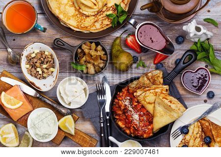 Colorful, Tasty And Savory Breakfast With Crepes And Different Fillings And Sauces. Top Vie