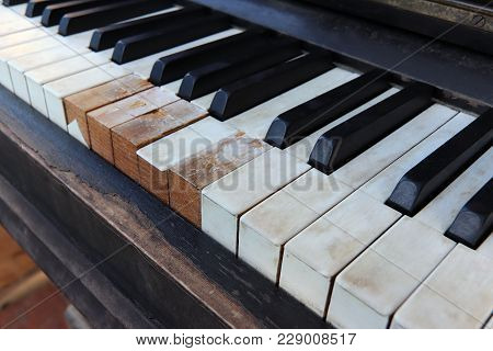 Detail Of Old, Broken And Dusty Piano Claviature
