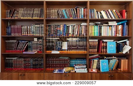 Saratov / Russia - February 25, 2018: Library In The Synagogue. Multi-colored Books On The Bookshelf