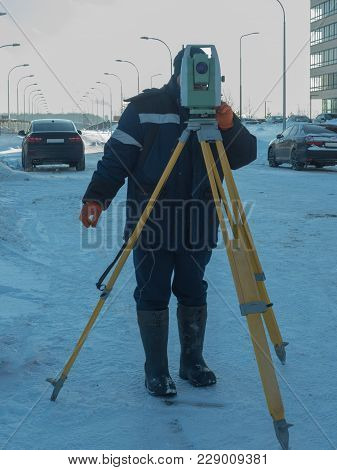 Engineer Works With The Theodolite. Moscow, Russia