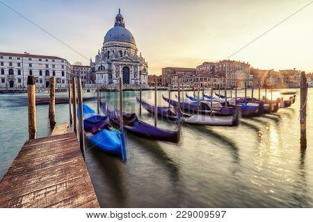 Venice, Italy - February 11: Parked Gondolas And Basilica Di Santa Maria Della Salute On February 11