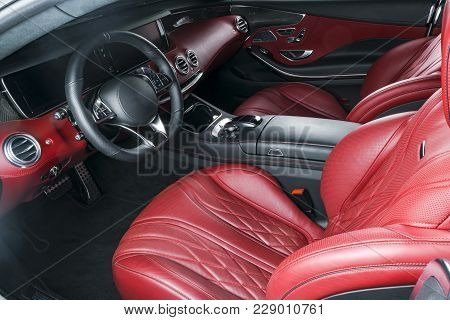 Modern Luxury Prestige Car Interior, Dashboard, Steering Wheel. Comfortable Perforated Leather Seats