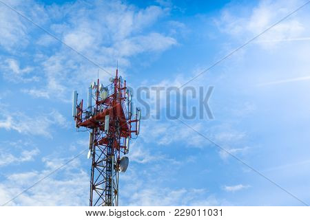 The Communication Tower On Blue Sky Background...