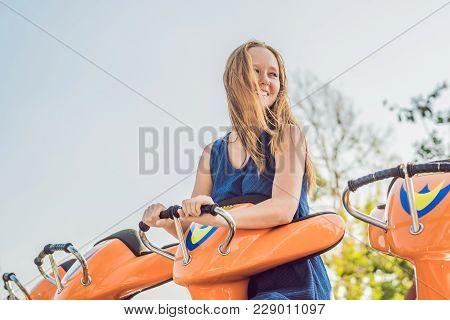 Beautiful, Young Woman Having Fun At An Amusement Park.