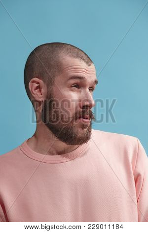 Young Casual Man Is Boring. Emotional Man Is Boring On Blue Studio Background. Male Profile. Human E
