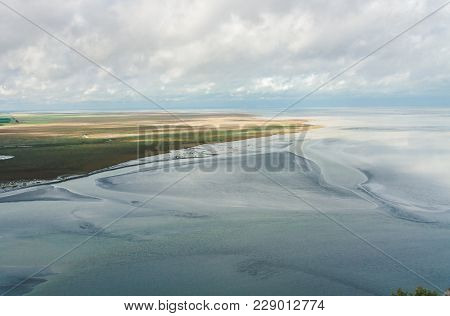 Scenic View On Coastline And Sea From Le Mont Saint-michel Island Famous For Low Tides In Normandy,