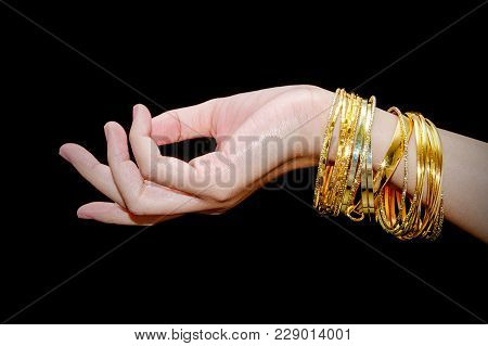Beautiful Woman Hand Hold Gold Bracelet Jewelry, Accessory And Fashion.