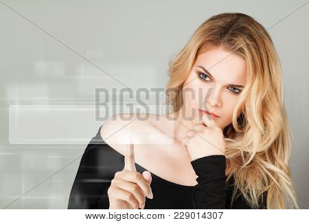 Young Blonde Woman Pointing. Www And Web Surfing Concept