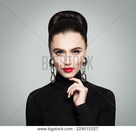 Fashion Portrait Of Beautiful Elegant Woman In Black Roll Neck Jumper. Hair Is Hair Bun  Hairstyle.